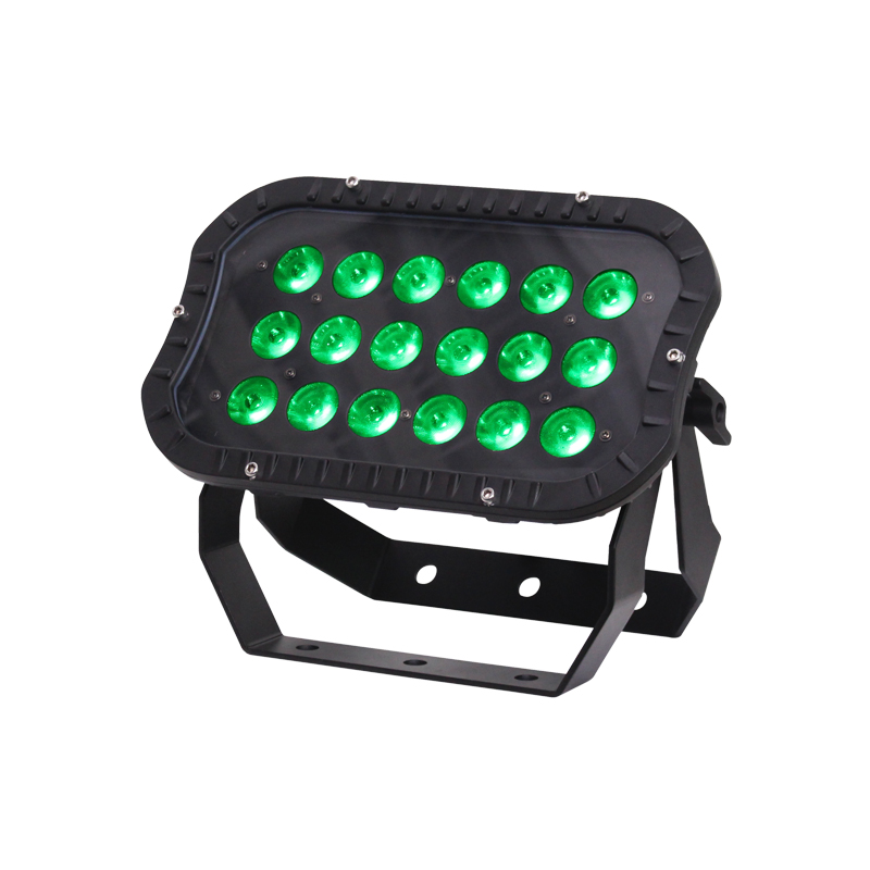 Spectra Flood 18T3 Exterior Fixture with LEDs lit up green.